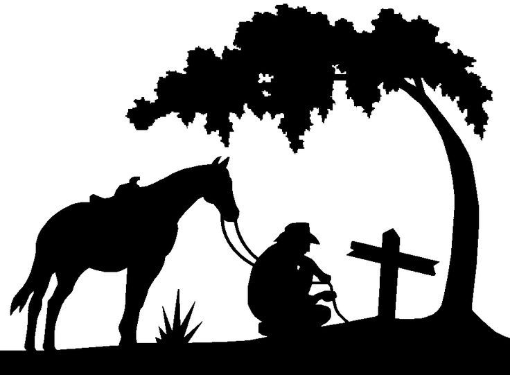 kneeling cowboy with horse.