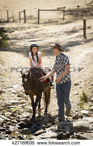 Stock Image of young jockey kid riding pony outdoors happy with.