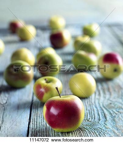 Stock Photo of Crab Apples on a Wooden Table 11147072.
