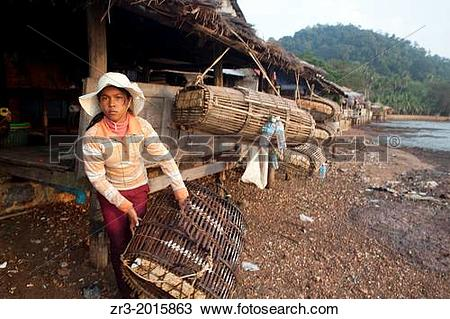 Stock Photo of A young woman crab fisherman in Kep, Cambodia. zr3.