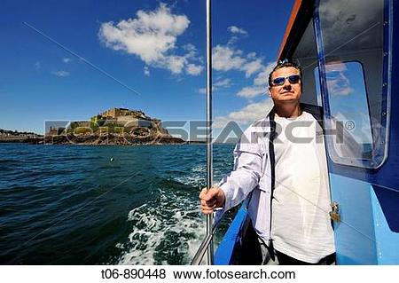 Pictures of Fisherman in his boat for crab fishing Guernsey.