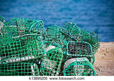 Stock Image of Lobster and Crab traps stack in a port k13895205.