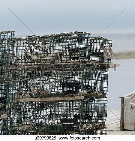 Stock Image of Crab traps stacked, Parson's Pond, Newfoundland And.