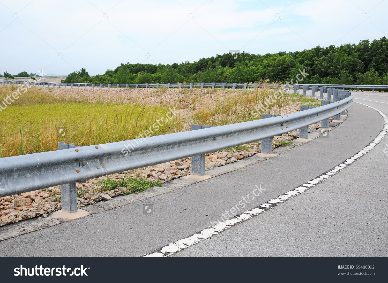 Highway Passing Through Countryside Crash Barrier Stock Photo.