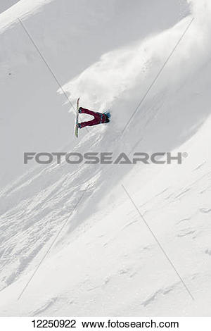 "Stock Photo of ""Snowboarder crashing down a mountain, British."