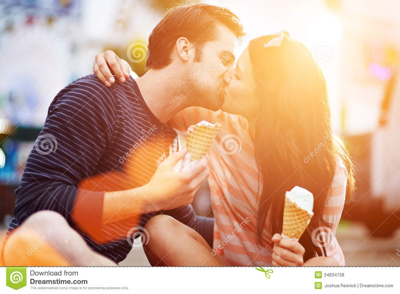 Romantic Couple Kissing While Holding Ice Cream Royalty Free Stock.