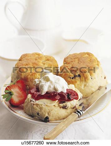 Stock Photography of Cream tea /scone, cream , strawberry jam.