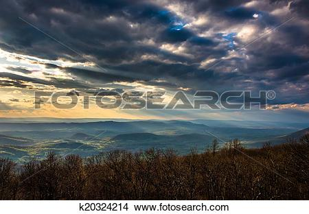 Stock Photo of Crepuscular rays over the Appalachians, seen from.
