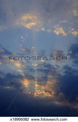 Stock Photo of Crepuscular rays at sunset x18995082.