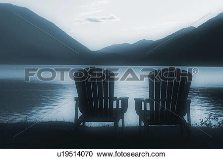 Stock Photography of lodge, chairs, crescent, lake, shore.
