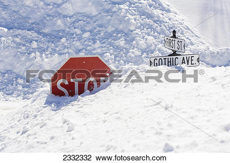 Stock Photo of Deep snowcovering stop sign in downtown Crested.
