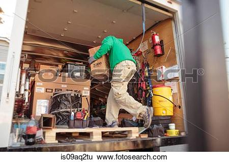 Stock Images of Solar panel installation crew member in truck.