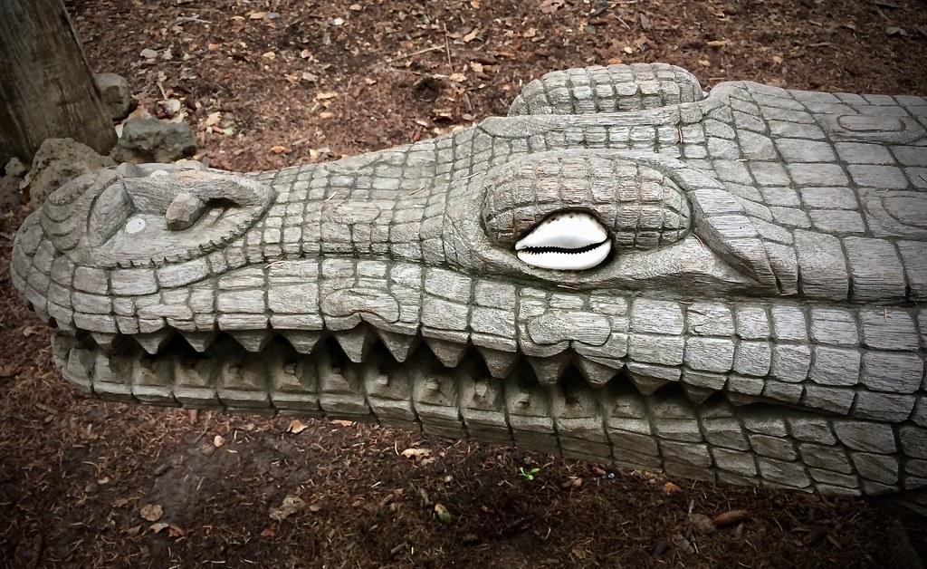 Crocodile head carving, PNG sculpture garden.
