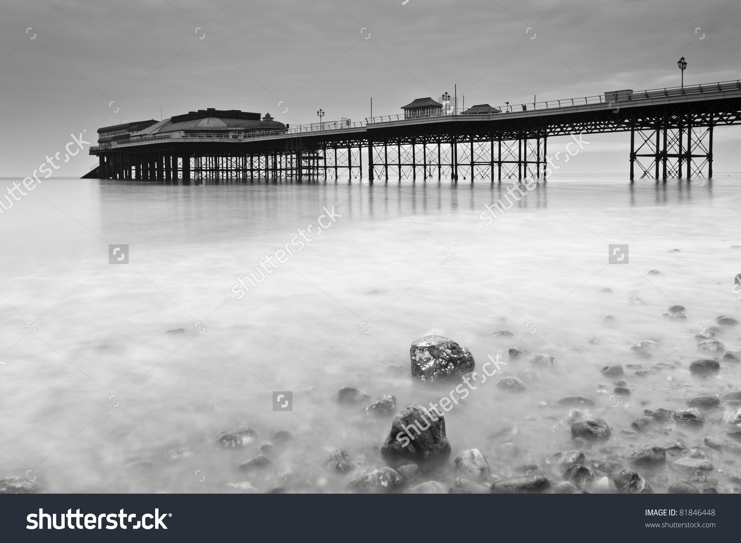 Cromer Pier At Dawn. A Slow Shutter Speed Blurs The Waves To.