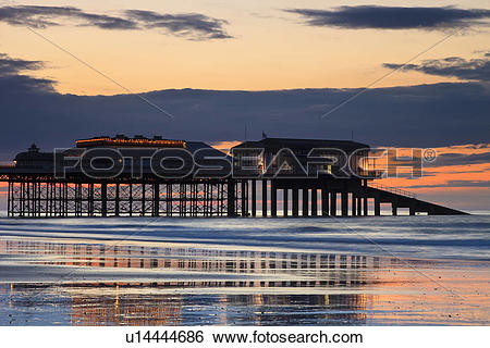 Stock Images of England, Norfolk, Cromer. Cromer Pier at sunset on.