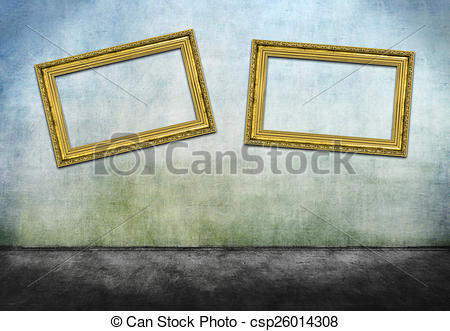 Stock Photography of Two crooked golden frames on gray dirty wall.