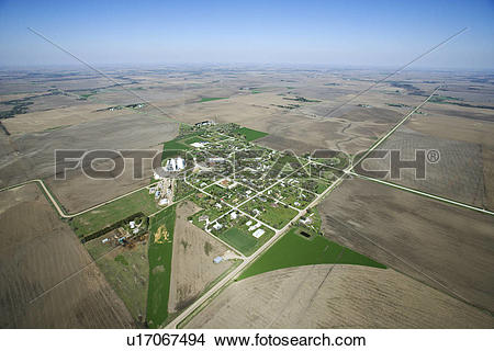 Stock Photo of Aerial view of rural town surrounded by cropland.