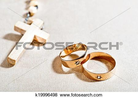 Pictures of Wedding Rings and Cross k19996498.