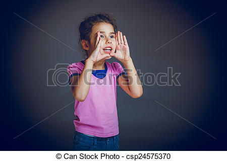 Picture of girl child faces calls hands on gray background cross.