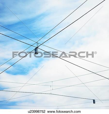 Stock Photo of Low angle view of blue sky and street lights with.