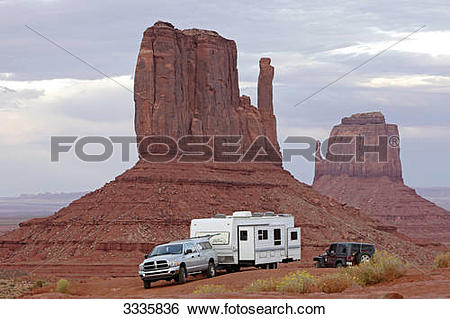 Stock Images of Cross country vehicle and camper in front of a.