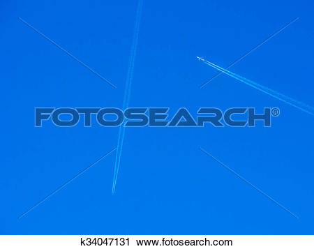 Stock Photography of Crossing Paths Planes in Blue Sky k34047131.