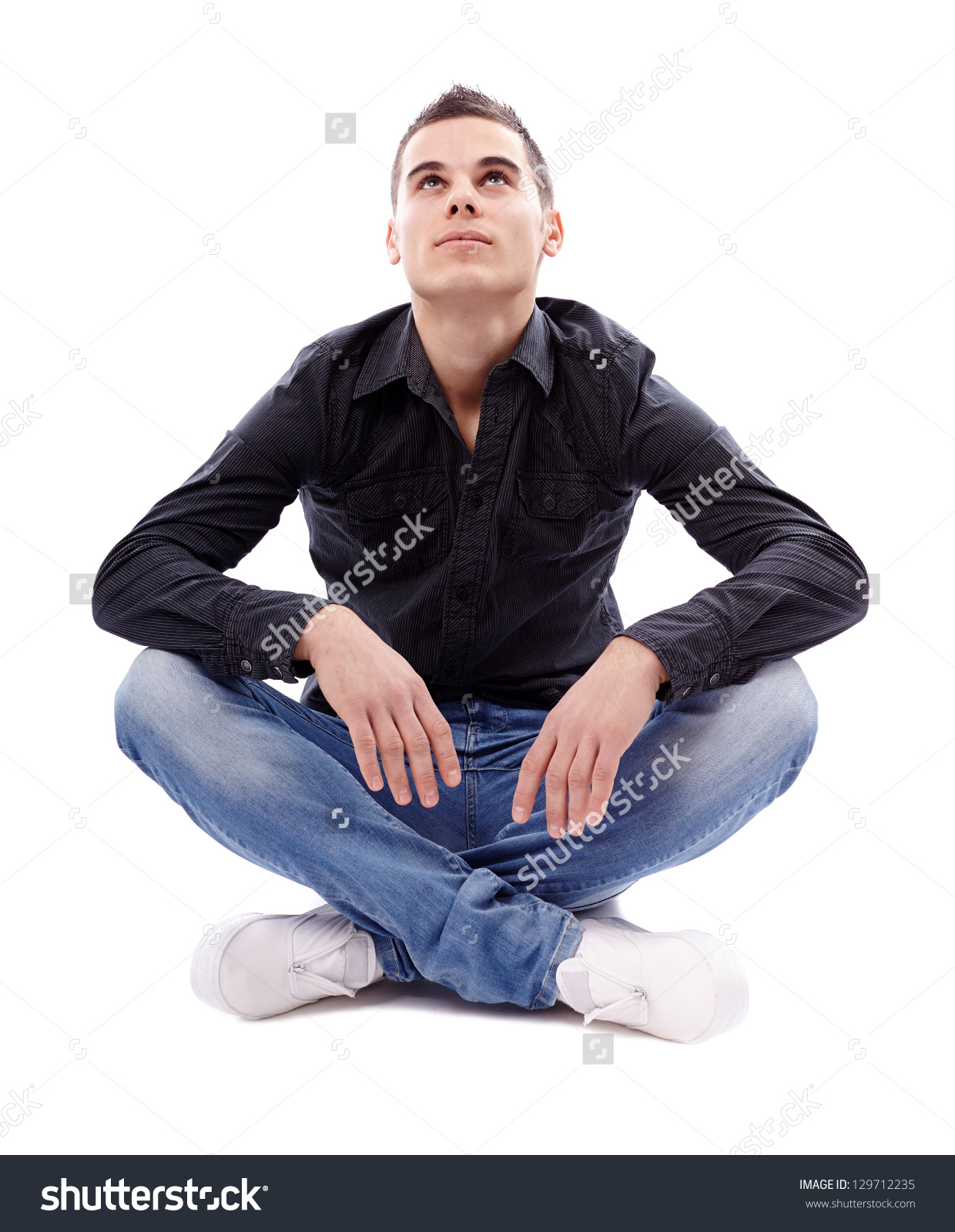 Casual Young Man Sitting Cross Legged Stock Photo 129712235.