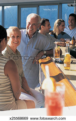 Stock Photograph of Six People Enjoying a Drink at the Bar of a.