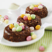 Stock Photo of Crunchy chocolate nests filled with multicolored.