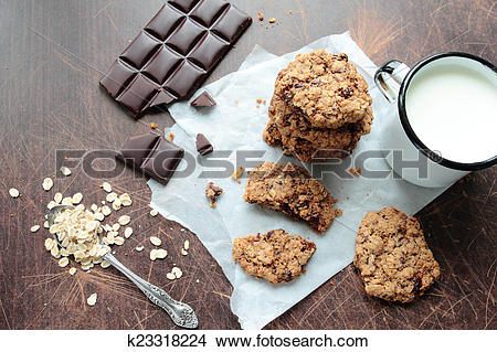 Stock Photo of Crunchy oat cookies with dark chocolate and mug of.