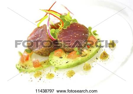 Picture of Tuna fish medallions with a crumb crust served with.