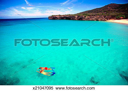 Stock Image of Couple snorkeling in crystal clear water off Knip.