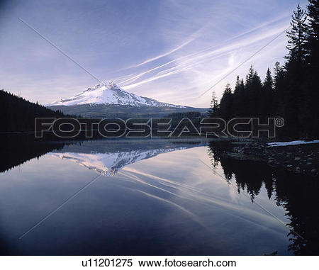 Stock Image of Thin Clouds Streak Sky Over Crystal Mountain Lake.