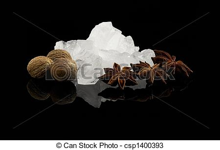 Stock Photos of crystal sugar and spice over black reflective.