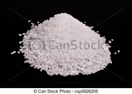 Stock Images of White crystal sugar pile isolated over black.