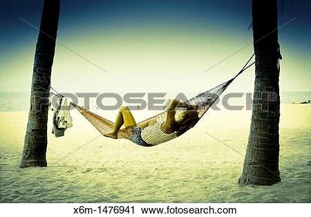 Stock Photography of people resting on a hammock Cua Dai beach Hoi.