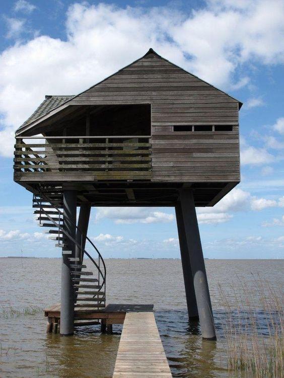 Kiekkaaste, Dollard, Netherlands. Wood house on stilts..