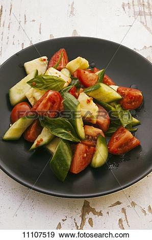 Stock Photograph of Tomato and cucumber salad with pineapple and.
