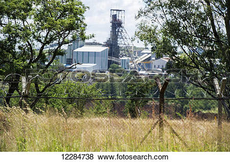 Pictures of Premier diamond mine behind barbed wire fence.