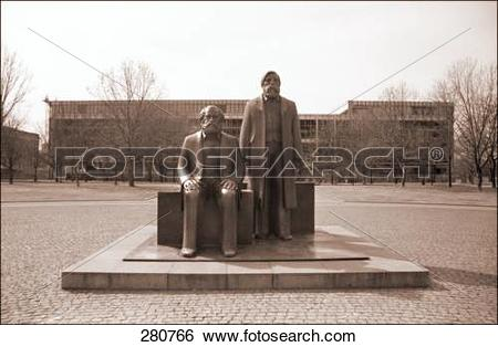Stock Images of Monument with cultural building in background.