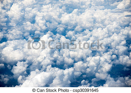 Stock Photo of Cloudscape. Blue sky and white cloud. Sunny day.