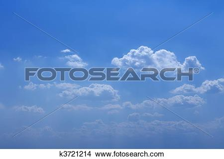 Stock Photo of Blue beautiful sky with white clouds in sunny day.