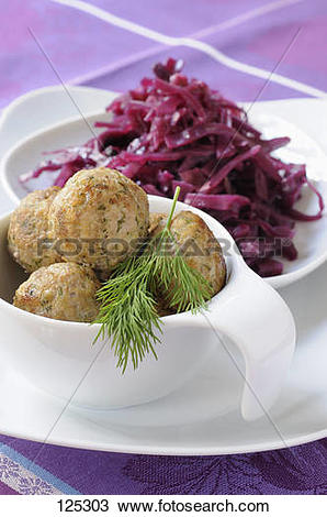 Stock Photo of Pork,dill and curry meatballs,sweet and sour red.