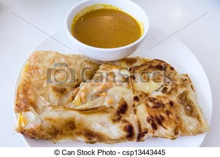 Stock Photo of Indian Roti Prata with Curry Sauce.