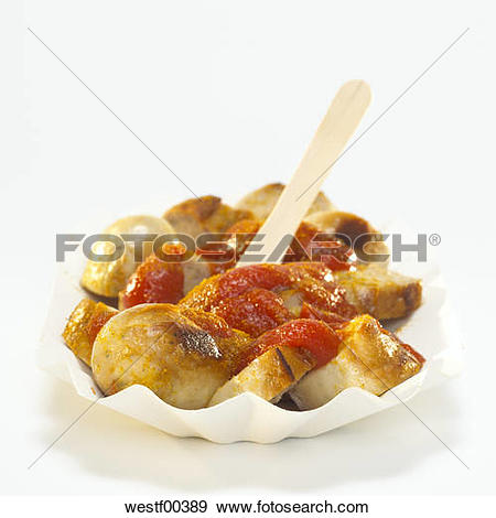Stock Photograph of Sliced sausage with curry sauce on paper plate.