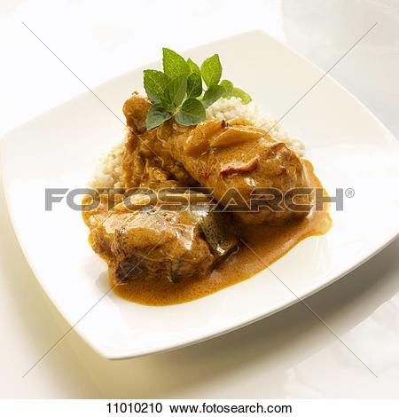 Stock Photography of Chicken with Red Curry Sauce Over Rice on a.