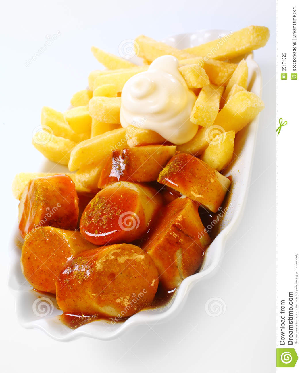 Crisp Fried Potato Chips With Spicy Currywurst Royalty Free Stock.