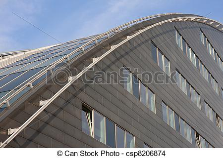 Stock Photo of Modern building with curved roof of glass.