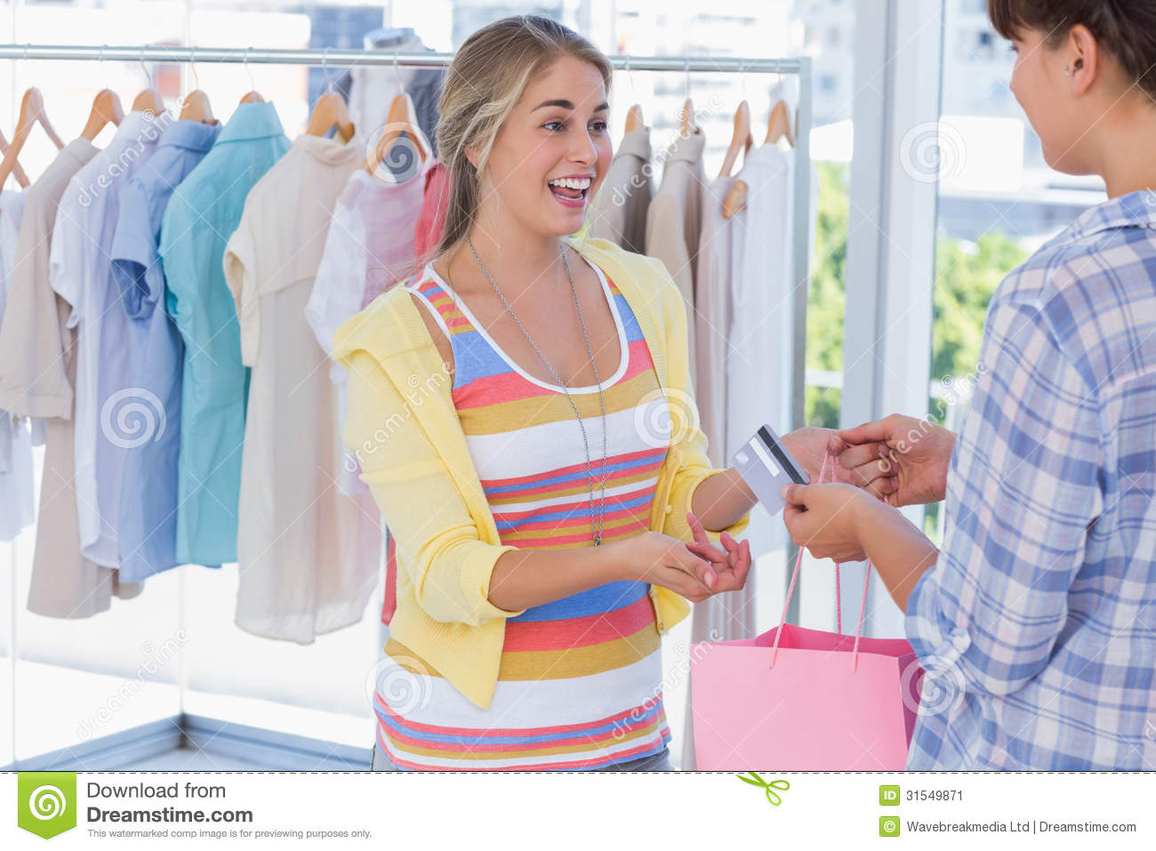 Cashier Clothing Store Cashier Giving Credit Card To Customer.