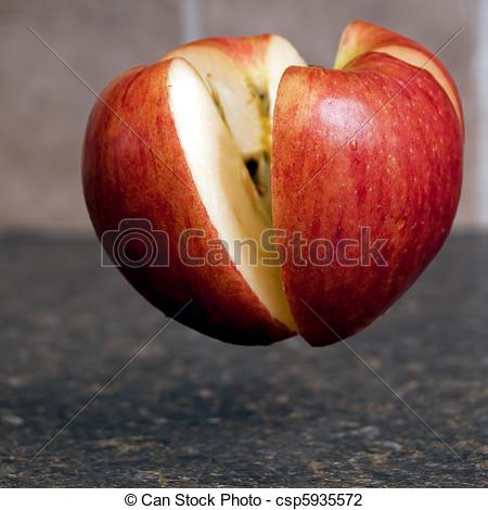 Stock Photo of Apple Being Cut in Half.